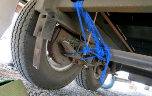 Temporary fix of broken spring to get 5th wheel to repair place