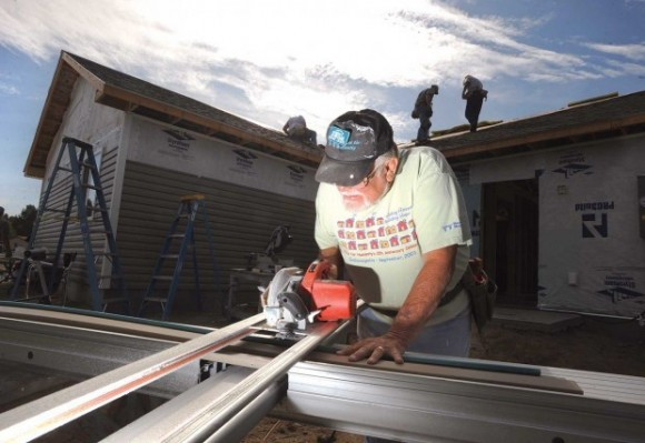 RV Habitat Care-A-Vanners pounding nails