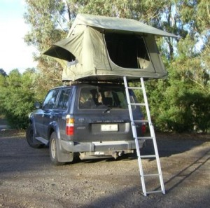 Car top tent camping = sleep safe above the mud, rocks and critters